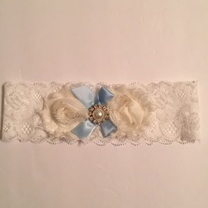 White and ivory lace garter with blue ribbon